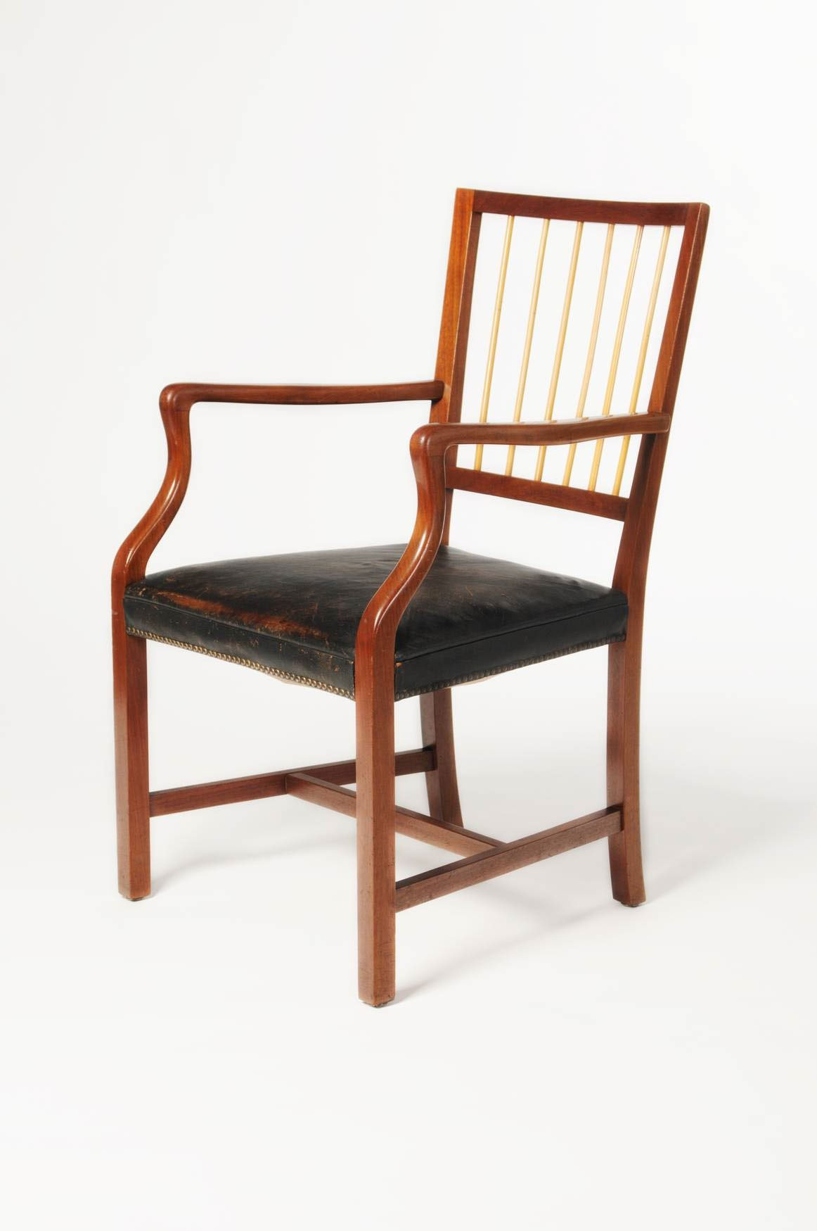 <BODY>Josef Frank, Armchair, Vienna, 1933<br />Mahogany, solid; rattan; upholstery with black leather cover<br />© MAK/Nathan Murrell</BODY>