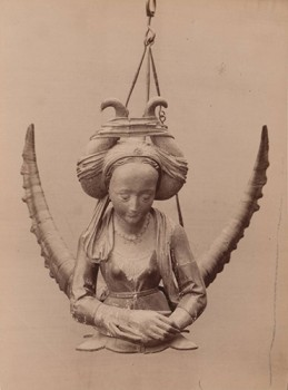 Photograph of a Chandelier with Female Figure