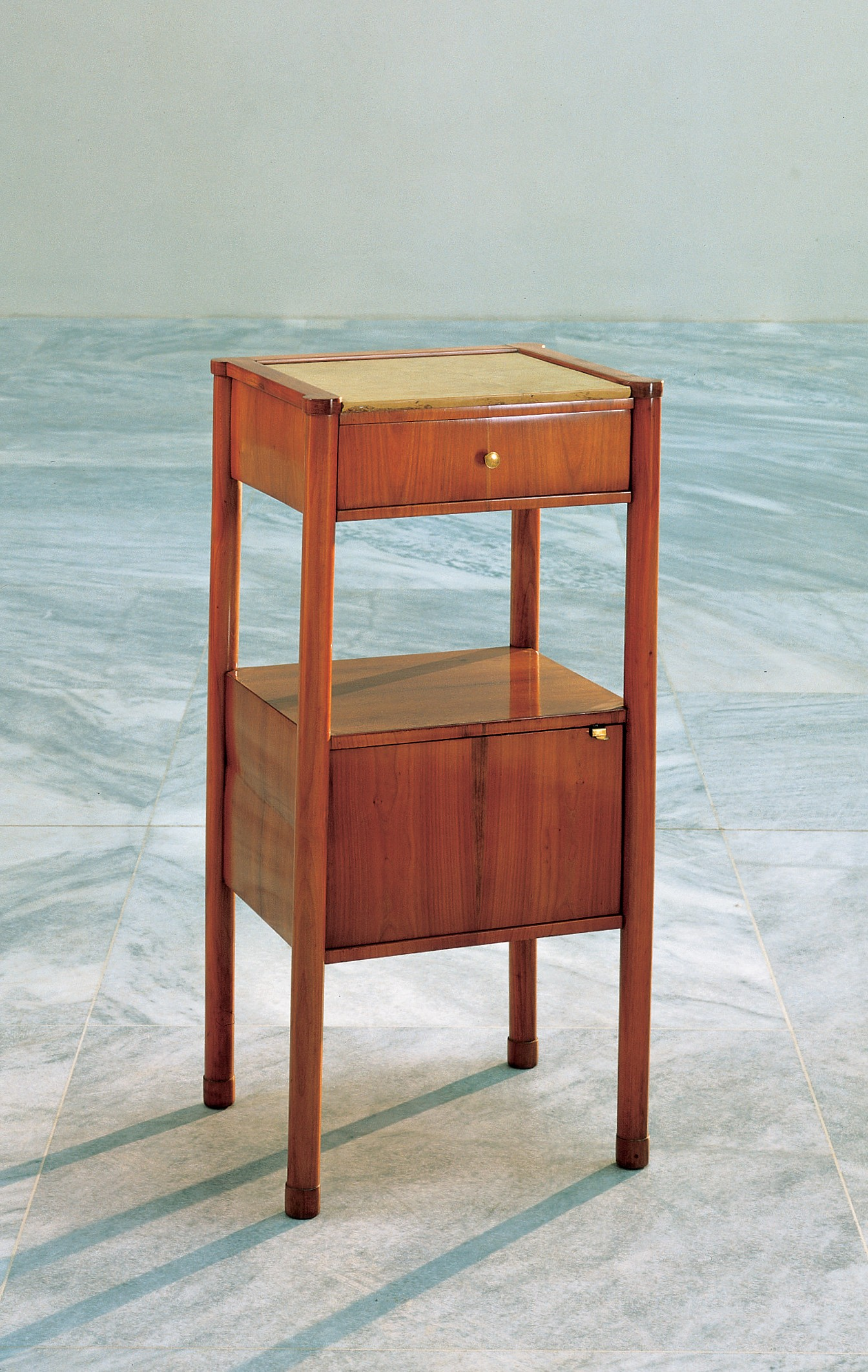 <BODY><div>BEDSIDE TABLE</div><div>Vienna, 1825–1830</div><div>Cherry wood, solid and veneered, Kehlheim limestone top, brass fittings</div><div>H 3042 / 1989</div></BODY>