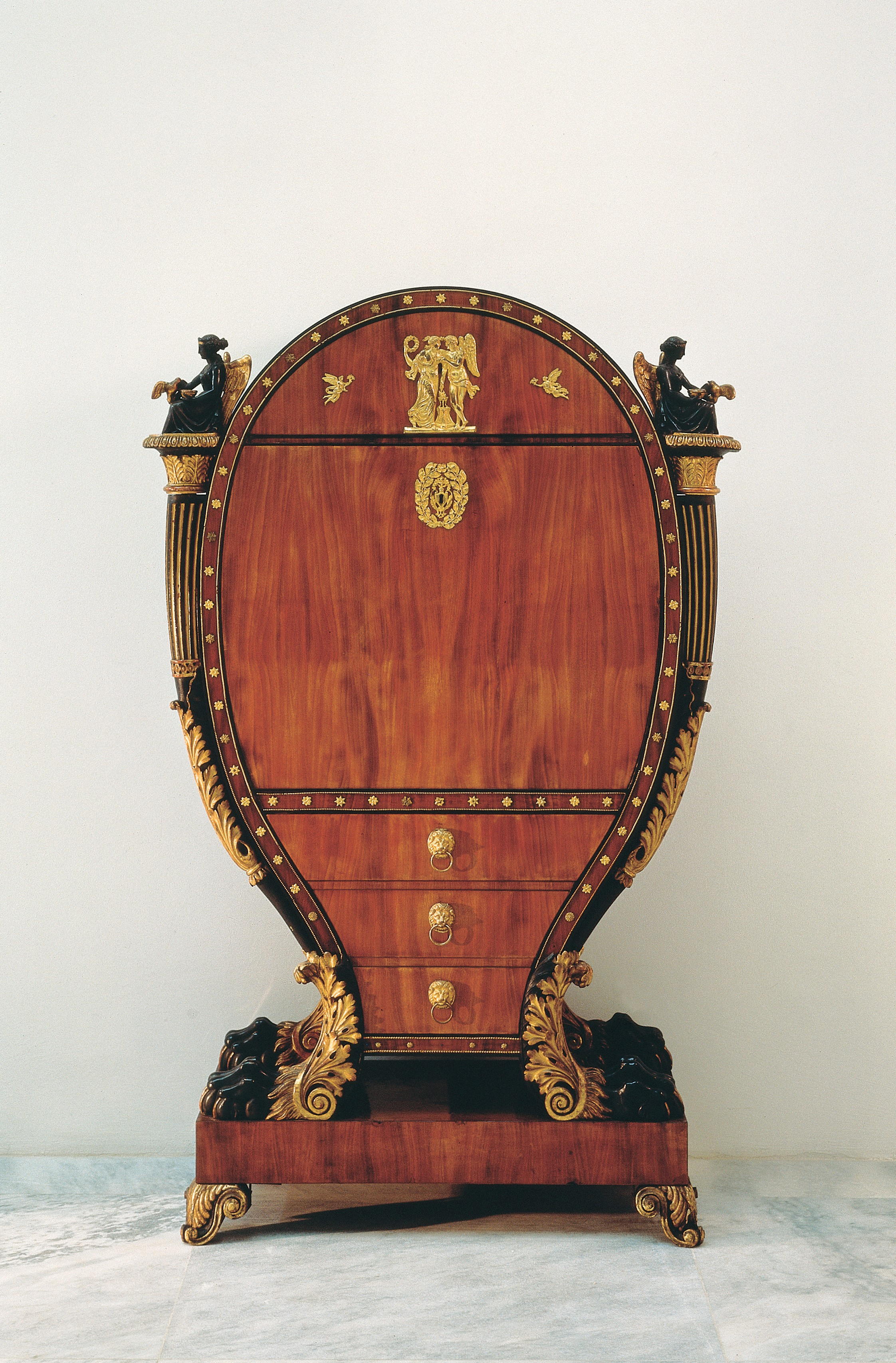 <BODY><div>BUREAU CABINET</div><div>Vienna, ca. 1815</div><div>Mahogany, black-stained wood, carved limewood, partly painted black and with verde-antique finish, partly gilded and bronzed; gilt brass and bronze fittings, partly solid and pressed; inside maple and red-stained grained wood</div><div>H 2027 / 1955</div></BODY>