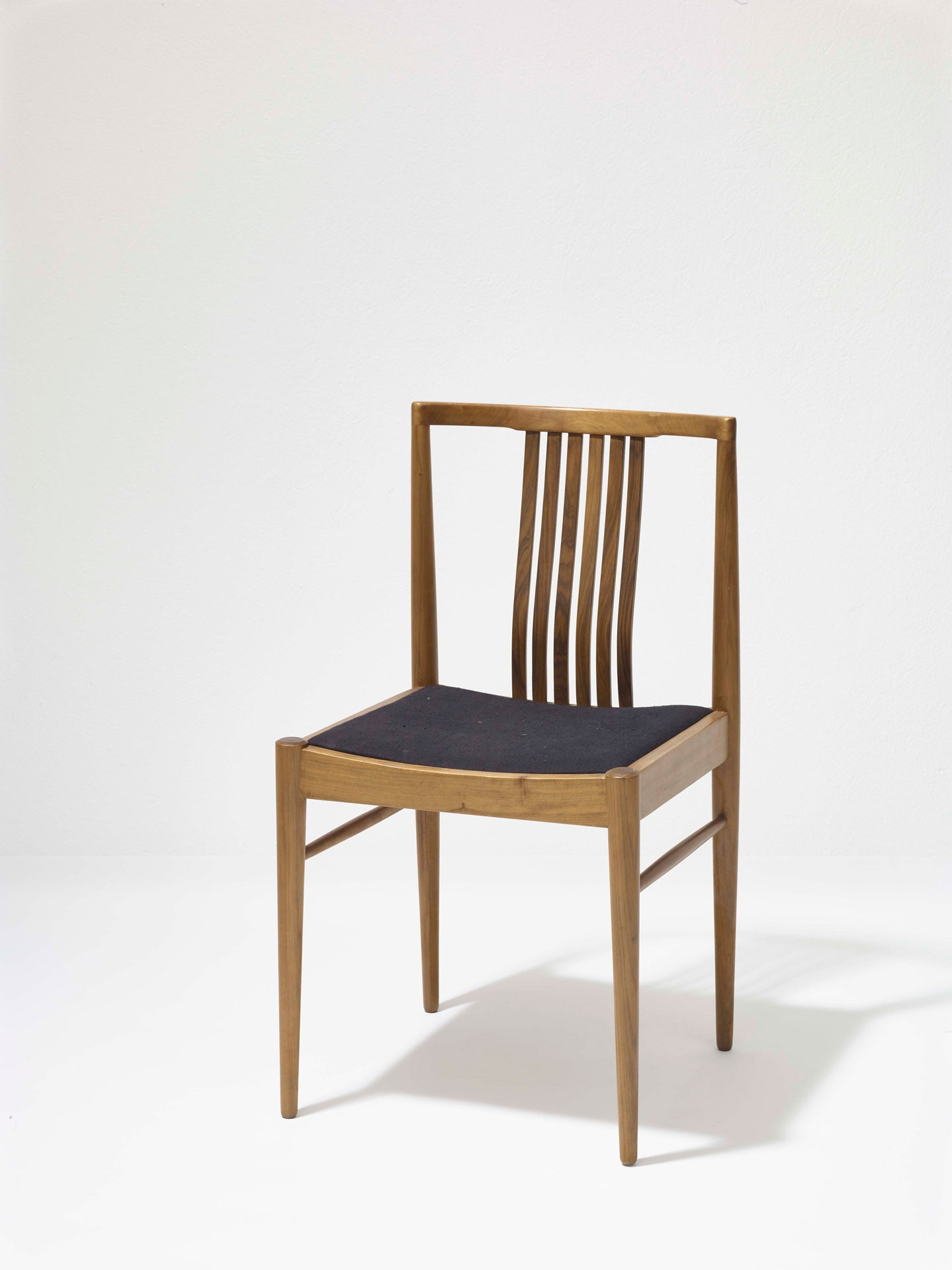 <BODY>Wolfgang J. Haipl, Chair, Vienna, 1963<br />Walnut wood, solid, partially laminated and bent; leather<br />© MAK/Georg Mayer</BODY>